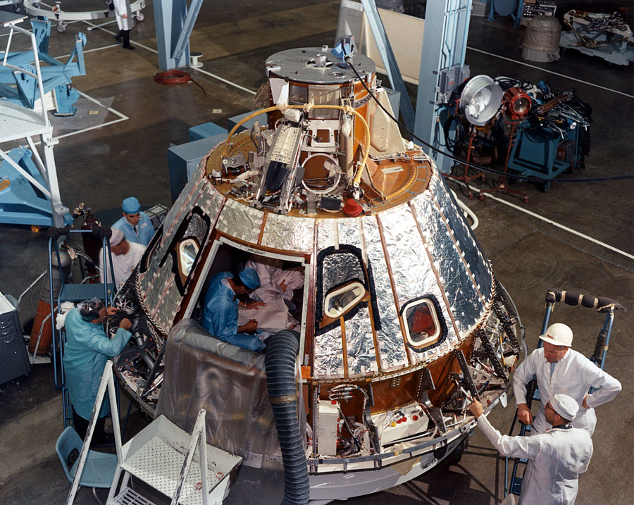 View_of_Spacecraft_012_Command_Module_during_installation_of_heat_shield_(small_image)