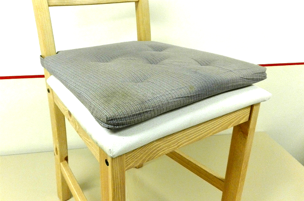 Image of a movable and a fixed chair cushion